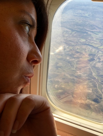 Wendie looking out the window over Spain.